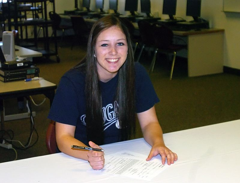 by: DAN BROOD - ON THE DOTTED LINE -- Sherwood High School senior Elyse Cuthbertson signs her national letter of intent to compete in track and field at Brigham Young University.
