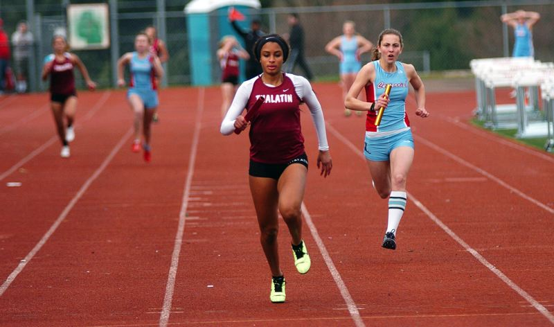 by: DAN BROOD - WINNER -- Tualatin junior Aryana Harvey is first across the finish line in the 4 x 100 relay.