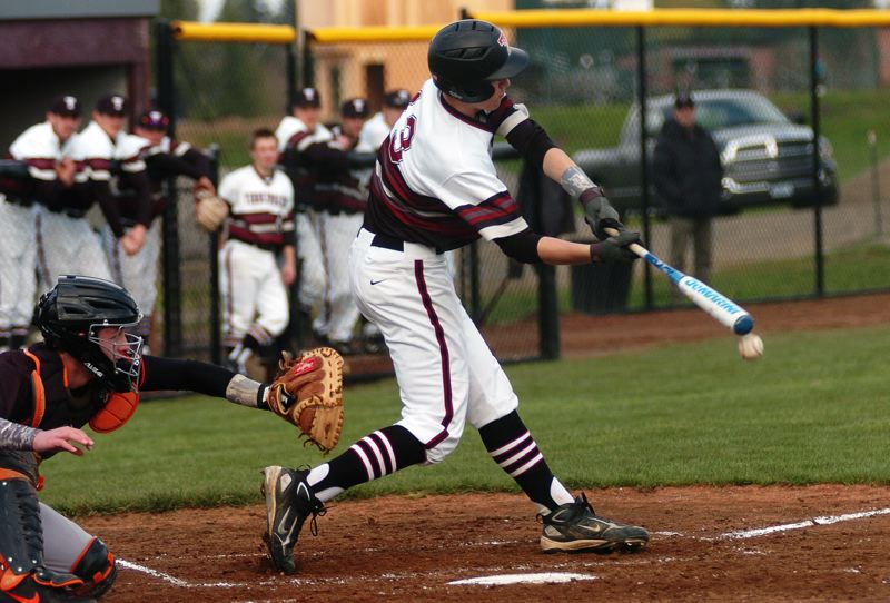 by: DAN BROOD - BAT ON THE BALL -- Tualatin junior Jacob Bennett rips a two-run single to left field in the first inning of last Thursday's game with Beaverton. Bennett had three hits for the Wolves in their 8-3 victory.