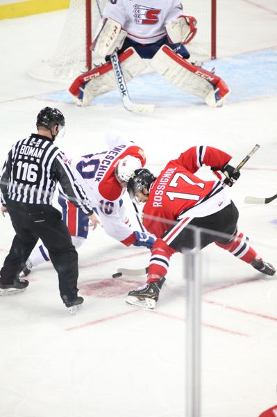 by: COURTESY OF BRYAN HEIM - Adam Rossignol (right), taking a faceoff, is one of the Portland Winterhawks three 20-year-old players, but he sees much less playing time than most of his younger teammates.