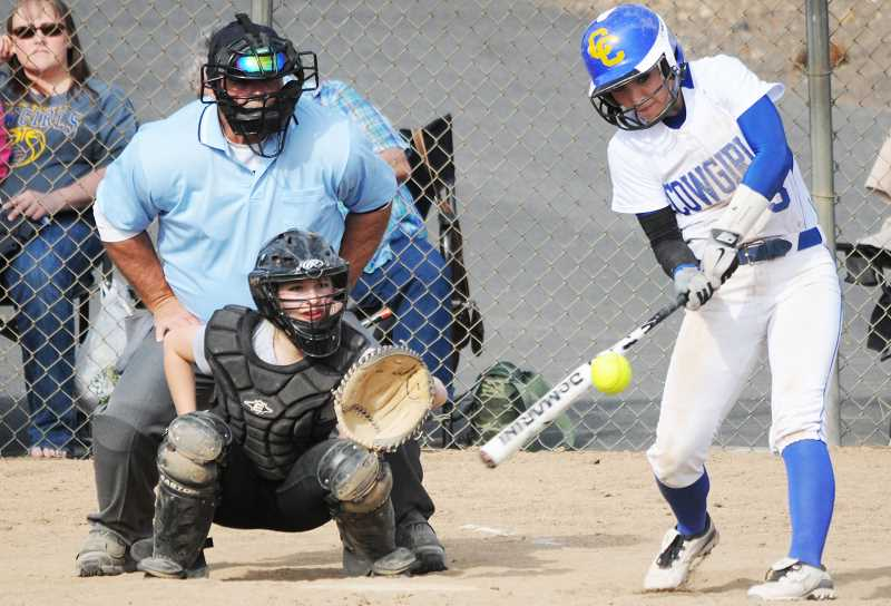 by: LON AUSTIN/CENTRAL OREGONIAN - Jena Ovens blasts a home run during the Cowgirls' 9-8 loss to Philomath Monday afternoon. Crook County finished with a 2-2 record at the Central Oregon Spring Break Softball Tournament which was held Monday and Tuesday at Skyline Sports Complex in Bend.