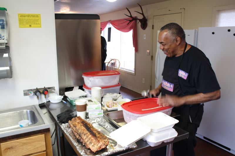 by: SPOTLIGHT PHOTO: ROBIN JOHNSON - Ron Washington, owner of Ron Rico's BBQ To Go, says one of his goals is to make his customers crack a smile upon tasting his grilled goods.
