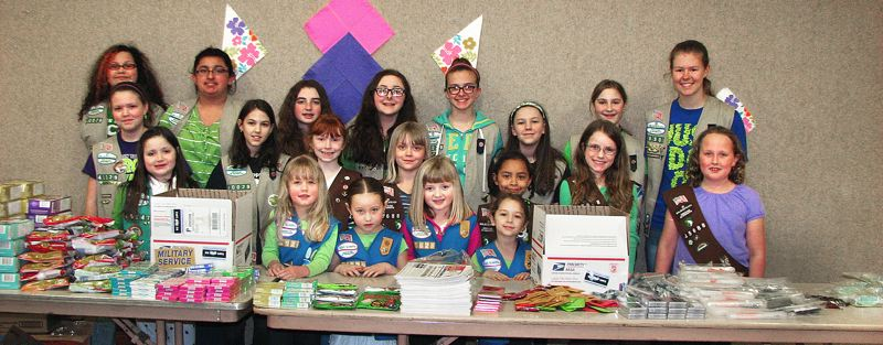 by: CONTRIBUTED PHOTO: AMBER MCMURRY - Twenty East County Girl Scouts ages 5 to 16 gathered last week to create care packages with cookies, letters and photos for American military personnel. They worked with Molly's Adopt A Sailor.
