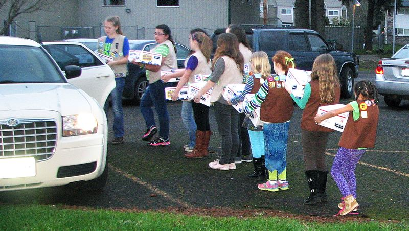 by: CONTRIBUTED PHOTO: AMBER MCMURRY - Girl Scouts make a parade to load vehicles with care packages before sending them overseas to Afghanistan.