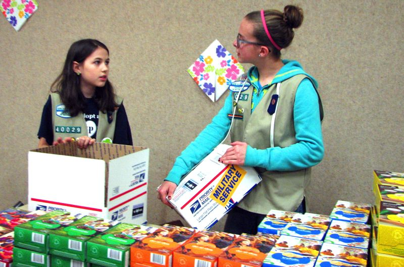 by: CONTRIBUTED PHOTO: AMBER MCMURRY - Rebecca and Kaitlin prepare to pack care boxes Monday, March 17.