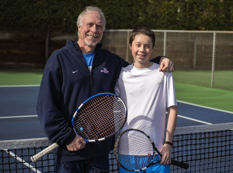 by: HILLSBORO TRIBUNE PHOTO: CHASE ALLGOOD - Century sophomore Tommy Edwards poses with his father and tennis coach, Dave Edwards, after a recent practice session. Edwards was a state tournament qualifier last year.