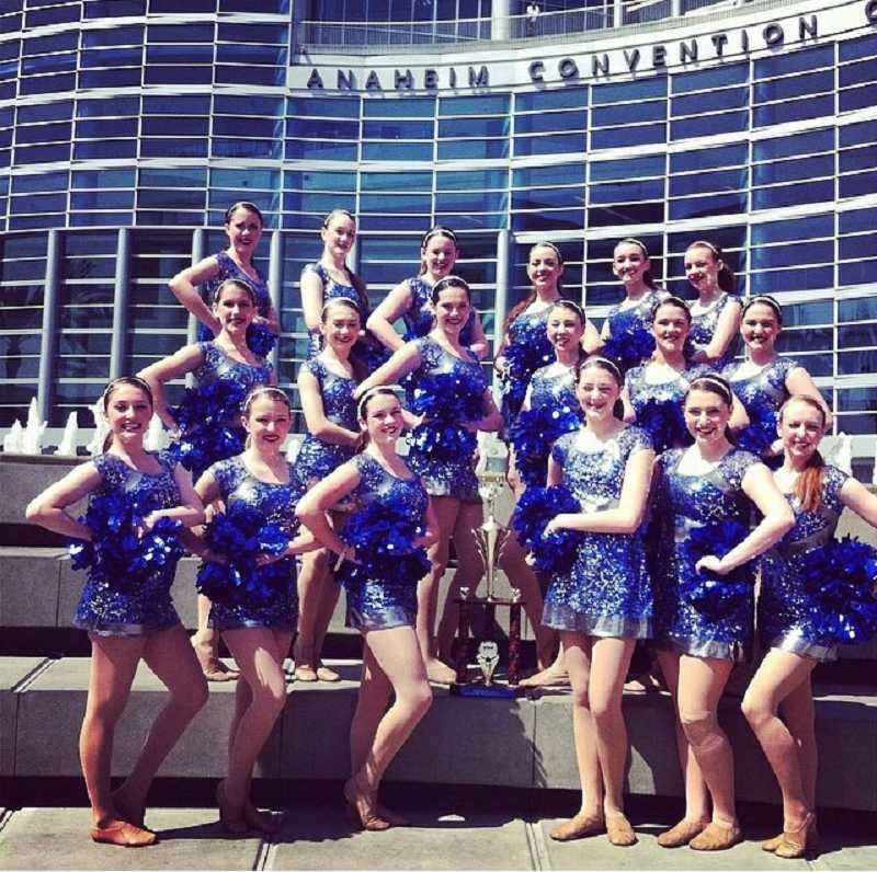 by: SUBMITTED PHOTO - The Wilsonville Pride dance team poses outside the Anaheim Convention Center in Anaheim, Calif., where they placed fourth in the jazz category at a national competition featuring teams from across the country.