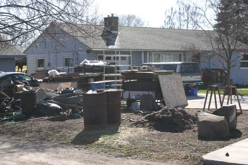 by: JASON CHANEY - The police department is working with the occupants of the above home to clean up junk and debris on the property.