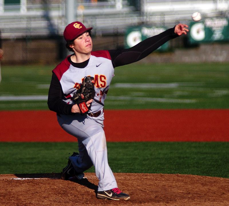 by: PAMPLIN MEDIA GROUP: DAN BROOD - Central Catholic High sophomore Sam Muskat delivers a pitch against Tigard.