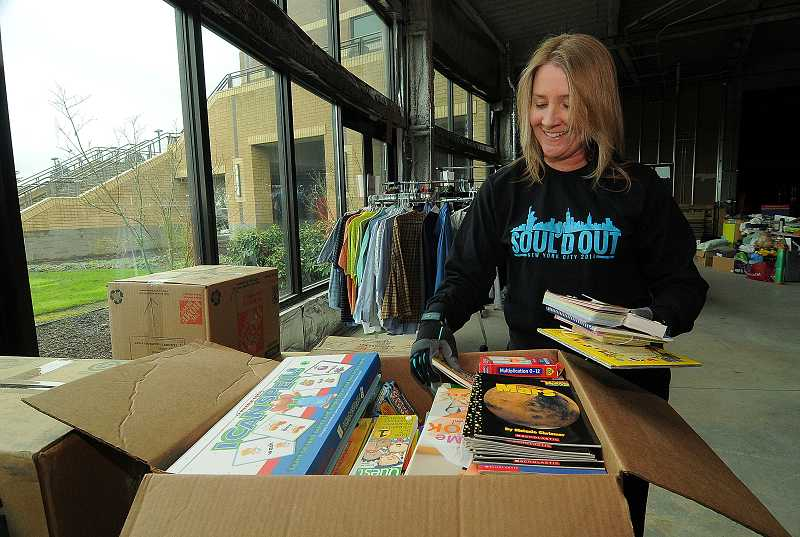 by: PAMPLIN MEDIA GROUP: VERN UYETAKE - Michele Jaffe's children attend schools in both West Linn and Wilsonville. She is organizing garage sale fundraisers to benefit groups at Athey Creek Middle School and Wilsonvile High School.
