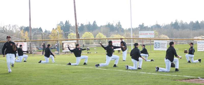 by: CORY MIMMS - The Indians warming up before their first preseason game. Molalla enters league play on Monday, April 7, at home versus North Marion.