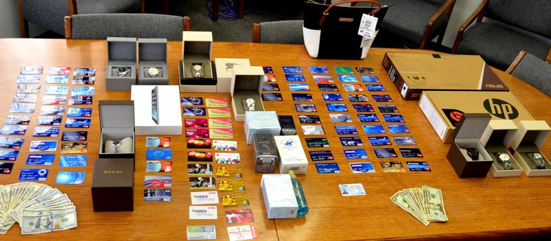 by: COURTESY OF BPD - Beaverton detectives recovered on Saturday nearly 100 counterfeit credit cards that had been used by two Miami men to buy thousands of dollars in items from a dozen Portland-area stores.