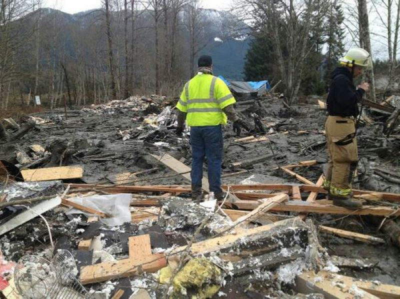 by: KOIN 6 NEWS - Rescuers look through the rubble of a home swept away by a massive landslide near Oso, Wash., March 22.