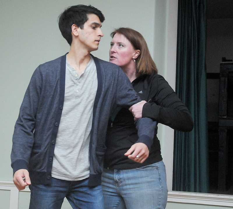 by: GARY ALLEN - Opening soon - Michah Bevins (Khaled) and Ruth Mandsager (Bartlett) rehearse a scene for Chehalem Players Repertory's play 'Back of the Throat.' The play opens April 25.