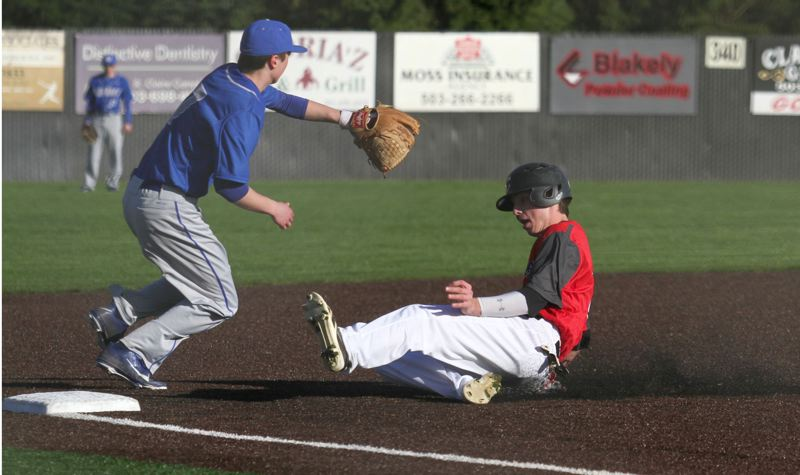 by: JON HOUSE - Speed demon Elliott Cary takes an extra base in Clackamas 7-2 season-opening win over Grant. Cary, a transfer from Florida who has signed with Oregon State University, had six stolen bases in thea Cavaliers first six games.