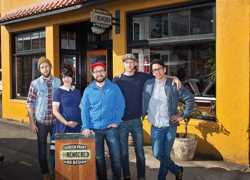 by: EMILY HAVEN - Newberg's top business - Nate Travers (center) and his staff at Rendered Graphics & Design will be recognized as the 2013 New Business of the Year at the Chehalem Valley Chamber of Commerce banquet April 11 at the Chehalem Armory Center.