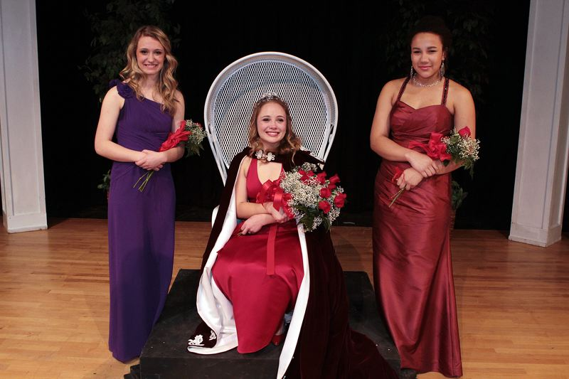 by: DAVID F. ASHTON - 2014 Portland Rose Festival Franklin High Princess Isabella Rigelman is seated, flanked by candidates Meggie Kirchner and Elana Wilson.