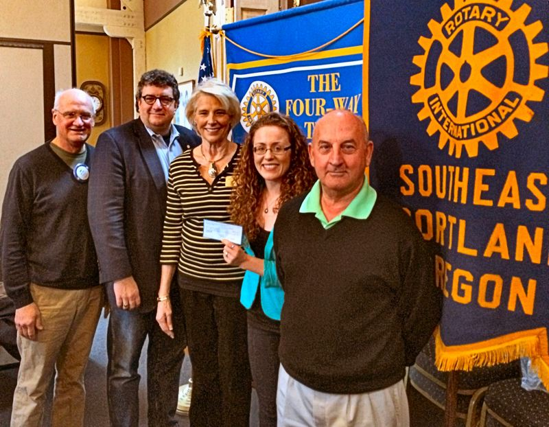 by: MARK HANSET - Southeast Portland Rotary presented a $5,000 grant to local nonprofit Raphael House at its February 24th meeting at Eastmoreland Golf Clubs clubhouse. Shown, at the presentation, from left, are Joel Fields, club Treasurer; David Tate, club President; Kathy Stromvig, past club President; Amanda Grebner of Raphael House; and Joe Amato, veteran club member and past President, who headed the club committee responsible for making the grant.