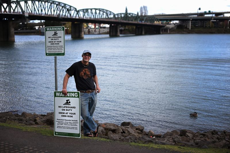 by: TRIBUNE PHOTO: JONATHAN HOUSE  - Will Levenson, ringleader of the Human Access Project, is working with the parks bureau by installing new signs promoting safe swimming at Gov. Tom McCall Waterfront Park.
