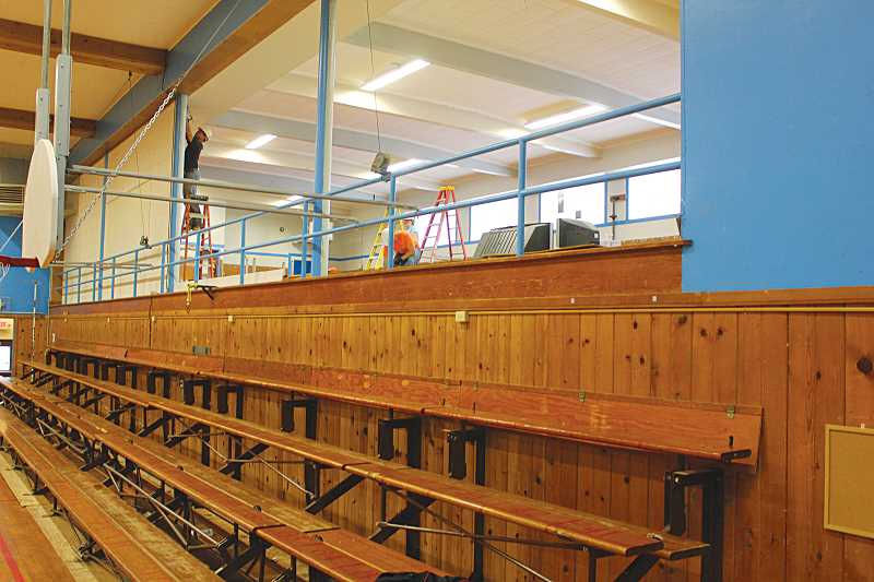 by: SUSAN MATHENY - Fresh air flowed between the upper and lower levels of the gym after the wall was removed. Plexiglass panels will be installed on the rails.