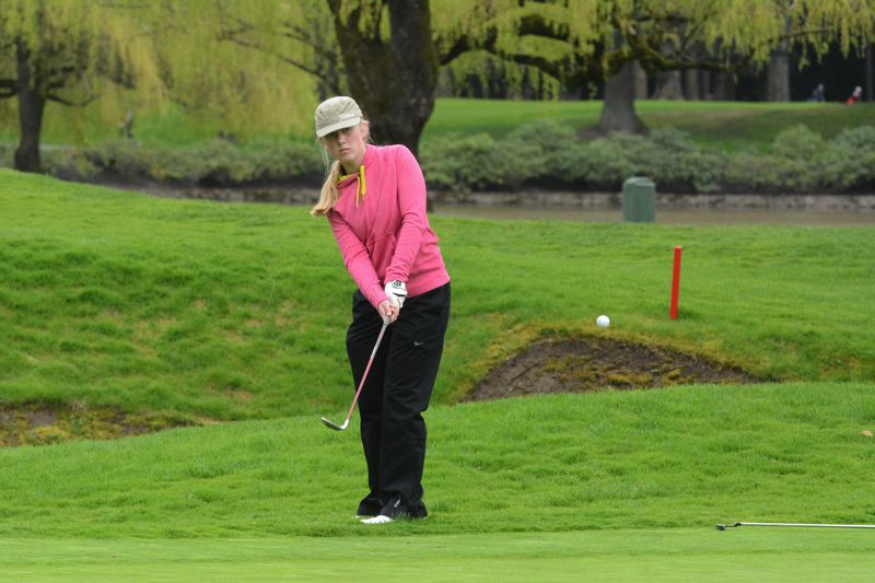 by: TIMES PHOTO: MATT SINGLEDECKER - Southridge junior Marissa King chips onto the green on the 17th hole at Portland Golf Club.