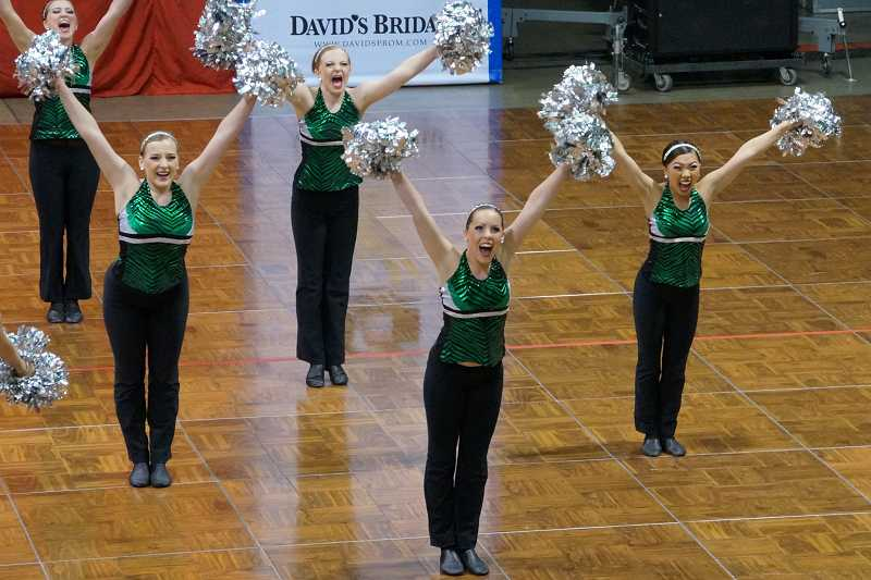 SUBMITTED PHOTO - Tigerette dancers Rachael Keenan, Camryn Flint, Rachel Blackwell and Amanda Lam dance during Saturdays national championship in Anaheim, Calif. The school brought home first place and two second-place finishes, the best any school in Oregon has ever done at the competition.