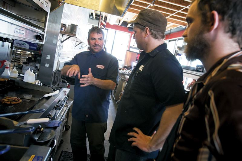 by: TRIBUNE PHOTO: JONATHAN HOUSE - Rick Gencarelli talks with his crew at North Williams. The restaurant gets its name from the Italian Italian-style pork fatback that is cured and crusted with salt, pepper, rosemary and other spices. Gencarelli first cooked his fries in a mixture of lard and canola until opening the Hawthorne restaurant, then quit because of it was too expensive and vegans complained. He plans on reintroducing it sometime this year, with a no-lard option.