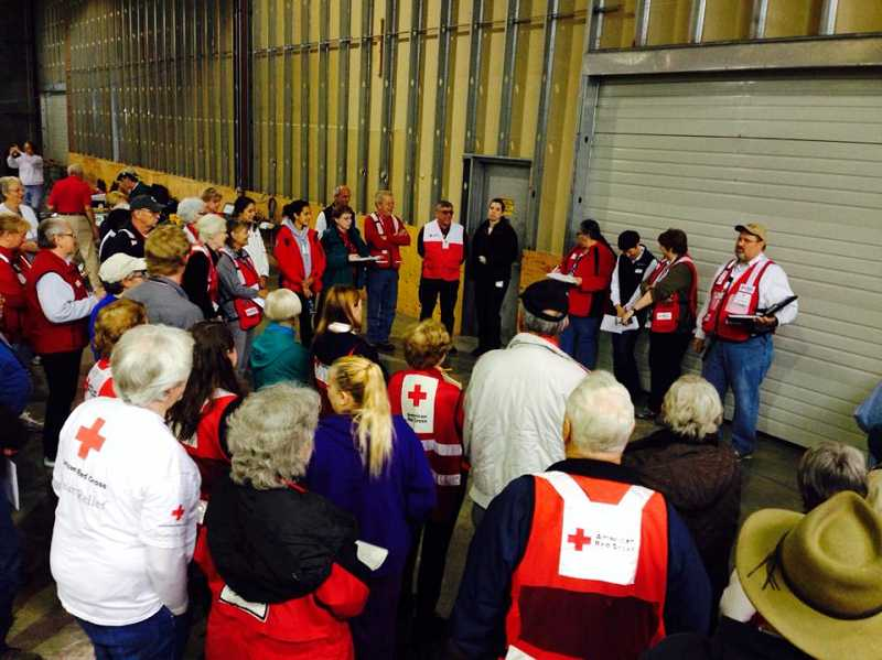 by: AMERICAN RED CROSS - Briefing for Red Cross workers at the Oso, Wash. mudslide disaster