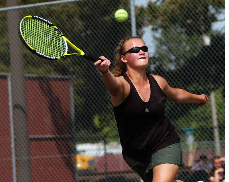 by: DAN BROOD - TOP TIGER -- Tigard senior Courtney Roshak, who qualified for the state tournament in doubles play last year, will be in the No. 1 singles spot for the Tigers this season.