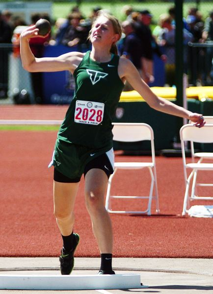 by: DAN BROOD - POWER -- Tigard High School sophomore Elise Conroy, shown here at last year's Class 6A state meet, should be a force for the Tigers in both the shot put and discus events.