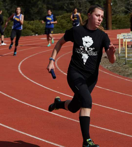 by: PHOTO COURTESY OF DOUG SMITH - Audrey Bernard runs the anchor leg of the 4x100 relay for the Cowgirls. Crook County won the relay with a time of 53.31. Bend and Crook County tied 70-70 in the girls meet while Bend won the boys meet 90-55.