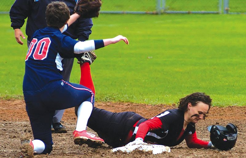 by: THE OUTLOOK: PARKER LEE - Mt. Hoods Teauna Hughes slides back into second base during the teams 10-6 win over Lower Columbia in the first game of a doubleheader Tuesday.