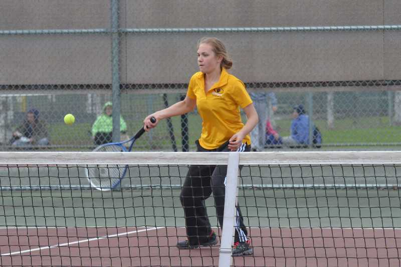 by: JEFF GOODMAN / PAMPLIN MEDIA GROUP - Susanna Chernishoff focuses on the ball April 4 during a girls tennis match between Canby and North Marion. Chernishoff and partner Sami Ingle won at No. 4 doubles to give the Cougars a 5-3 victory.