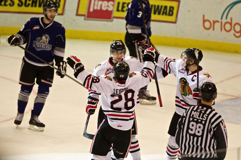 Brendan Leipsic of the Portland Winterhawks celebrates a goal by Oliver Bjorkstrand in the second period.