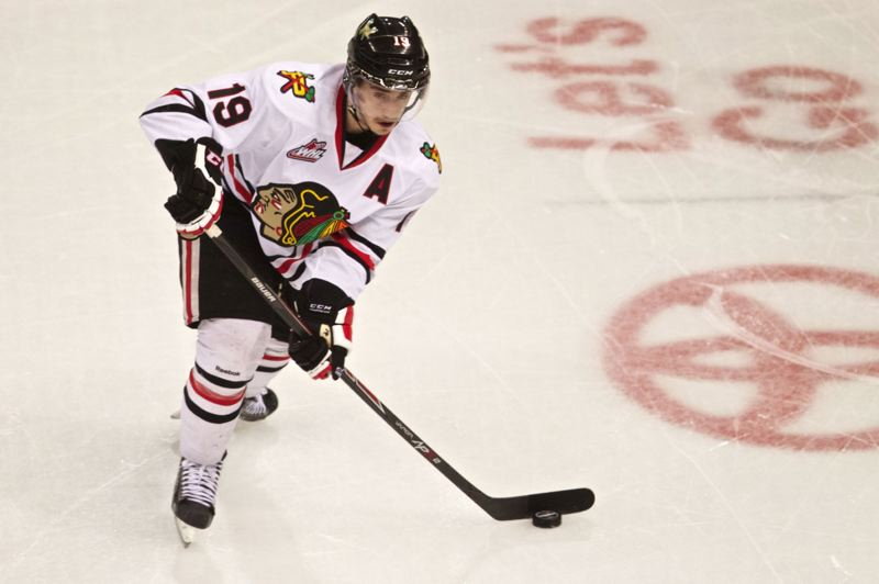 Nic Petan of the Hawks looks to shoot.