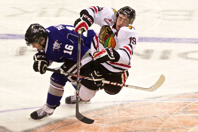 Victoria's Jack Palmer collides with Nic Petan during the second period Friday at Memorial Coliseum.