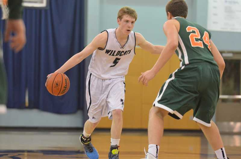 by: JEFF GOODMAN / PAMPLIN MEDIA GROUP - Sophomore wing Tyler Hieb, who earned all-state honorable mention, was one of five players on the Wilsonville boys basketball team to receive all-NWOC recognition.