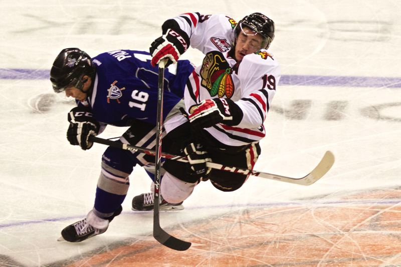 by: PAMPLIN MEDIA GROUP: JAIME VALDEZ - Portlands Nic Petan collides with Victorias Jack Palmer at center ice during the Winterhawks 6-3 win in Game 2 to take a 2-0 lead in the Western semifinals.