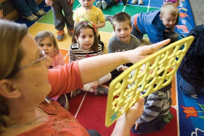by: KEVIN SPERL - Youth Services Associate Mary Ryan leads Growing Tales story time at the Crook County Public Library.