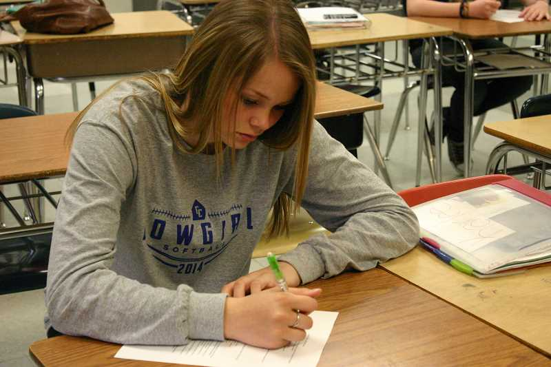 by: JASON CHANEY - Karlee Hollis takes a quiz in Mr. Raasch's AP U.S. history class.