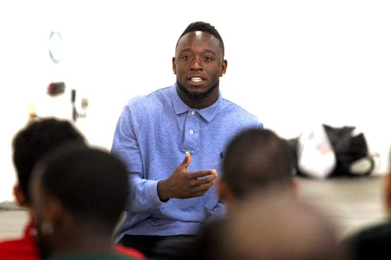 by: OUTLOOK PHOTO: JIM CLARK - Former Oregon running back De'Anthony Thomas shares his story with students at Reynolds High School on Thursday, April 3. Thomas grew up in South Central Los Angeles. He was motivated by sports to become a leader and pursue his dreams.
