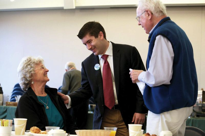by: TRIBUNE PHOTO: JONATHAN HOUSE - Jules Bailey chats with Katherine McDuffie and Allen Dobbins prior to the start of a debate with his Multnomah County Commission District 1 opponent, Brian Wilson, at the Terwilliger Plaza Retirement Community Saturday morning.