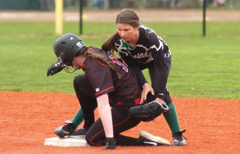 by: ESTACADA NEWS: PARKER LEE - Estacadas Skylar Hunter makes a tag at second base during last weeks home loss to 3A Corbett.