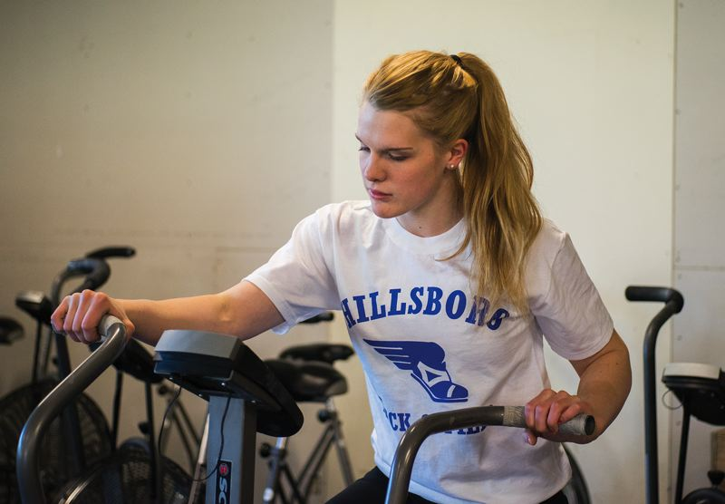 by: HILLSBORO TRIBUNE PHOTO: CHASE ALLGOOD - Hillsboro junior Anna Dean, who won a state championship in the 100-meter hurdles last spring, works out at CrossFit Reflexion in preparation for the upcoming track and field season.