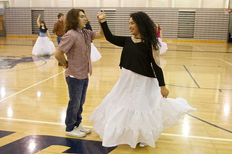 by: PAMPLIN MEDIA GROUP: JAIME VALDEZ - Andrew Fairrington & Carolina Ramirez Islas perfect the twirl during an early morning practice of the court dance.