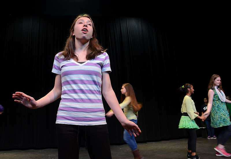by: PAMPLIN MEDIA GROUP: VERN UYETAKE - Three Rivers Charter School eighth-grader Keaton Straub plays Elinor Dunbar in the middle school musical production of Footloose. She is one of the upstanding citizens trying to keep order in their small town.