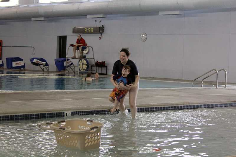by: TYLER FRANCKE | WOODBURN INDEPENDENT - Elsa Bonham, a swim instructor and lifeguard at the Woodburn Aquatic Center, and 5-year-old Tristan Smith, of Tualatin, enjoy some time in the pool Friday morning.