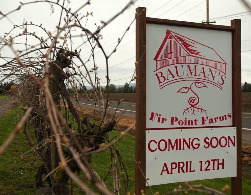 by: SPOKESMAN PHOTO: JOSH KULLA - The first 500 people to arrive at the Baumans at Fir Point grand opening Saturday will receive a free tomato plant.