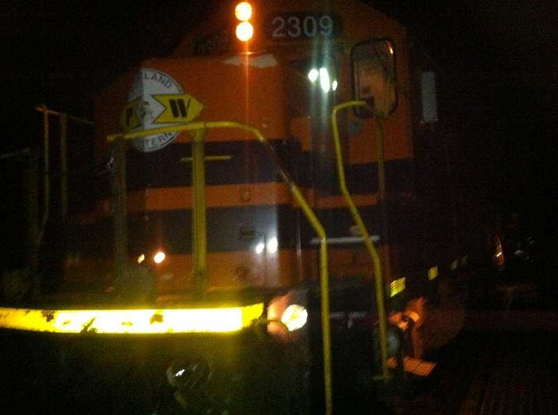 by: COURTESY OF WASHINGTON COUNTY SHERIFF'S OFFICE - Washington County sheriff's deputies are trying to determine why a man was crouching on the tracks before being struck by this Portland and Western Railroad engine late Monday night.