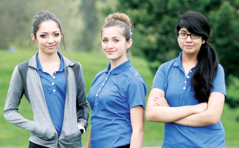 by: PHIL HAWKINS - From left, Woodburns Alexus Charitar, Wendy Hernandez and Belen Amaya lead the Bulldogs varsity girls golf team this spring season. Hernandez had the teams best outing to start the season after shooting a 68 to tie for 16th at Tukwila on March 31.